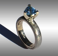 Gibeon Meteorite Ring set with Trillion Facet Blue Topaz